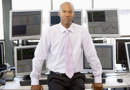 stock trader: Portrait Of Stock Trader In Front Of Computer Monitors Stock Photo