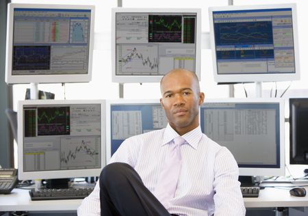 trader: Portrait Of Stock Trader In Front Of Computer Monitors Stock Photo