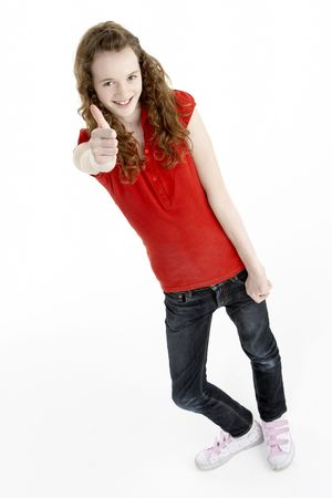 Full Length Portrait Of Young Girl Giving Thumbs Up
