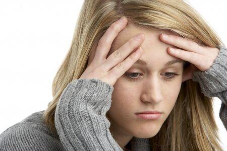 depressed teenager: Portrait Of Stressed Teenage Girl Stock Photo