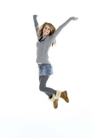 air jump: Full Length Portrait Of Jumping Teenage Girl Stock Photo