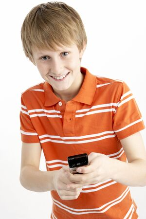 Young Boy With Mobile Phone photo