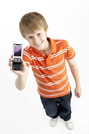 casual clothing 12 year old: Young Boy With Mobile Phone