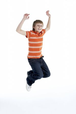 midair: Young Boy Jumping In Air