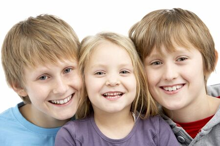 mischievious: Group Of Children In Studio Stock Photo