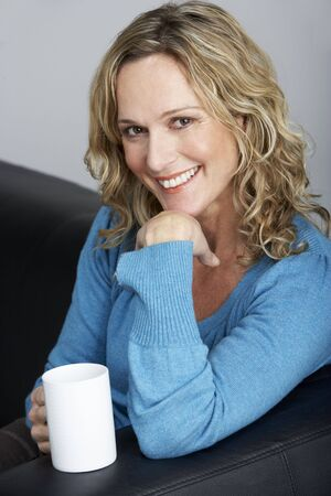 middle age woman: Middle Aged Woman Sitting On Sofa