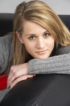 Teenage Girl Sitting On Sofa photo