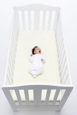 Newborn Baby In Cot photo