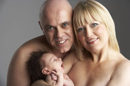 Parents Holding Newborn Baby photo