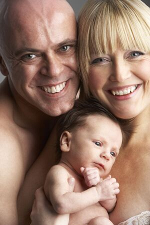 Parents Holding Newborn Baby Stock Photo - 5516869