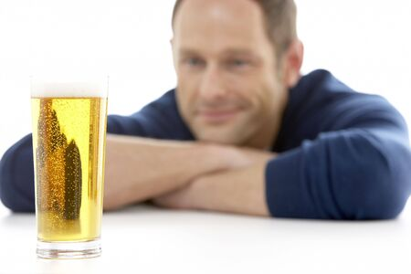 alcoholic man: Man Looking At Glass Of Beer