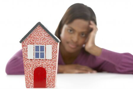 white interest rate: Woman Looking At Model House