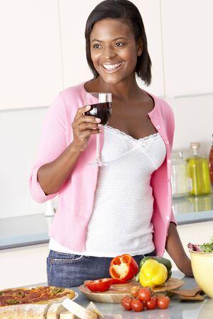 Woman Enjoying Glass Of Wine In Kitchen Stock Photo - 5516823
