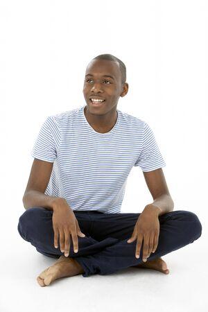 Teenage Boy Sitting In Studio Stock Photo - 5515863