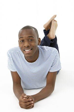 Teenage Boy Laying On Stomach photo