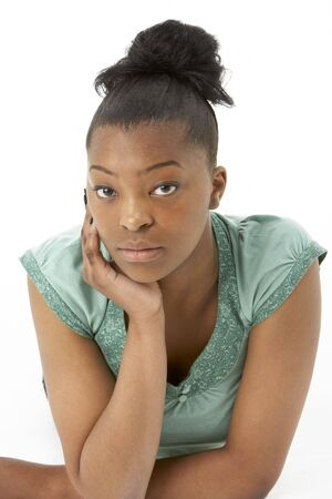 Studio Portrait Of Smiling Teenage Girl photo