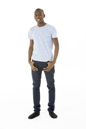 full length: Teenage Boy Standing In Studio Stock Photo