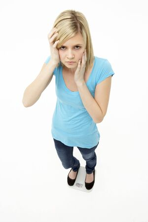 Worried Teenage Girl Standing In Studio Stock Photo - 5515576