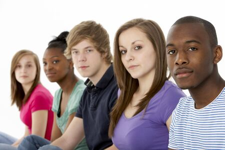 17 18 years: Group Of Teenage Friends In Studio Stock Photo