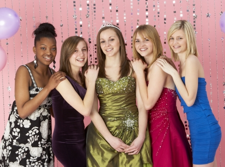 casual dress: Group Of Teenage Friends Dressed For Prom