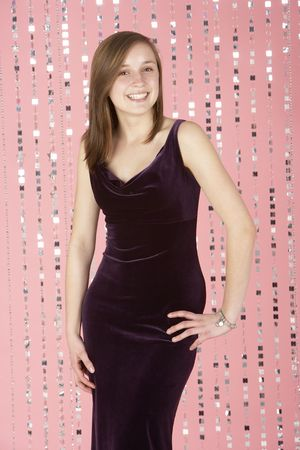 sixteen year old: Young Girl Wearing Party Dress Stock Photo