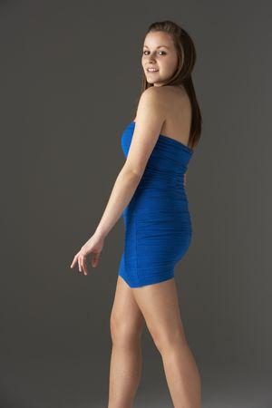 Teenage Girl Wearing Dress In Studio photo