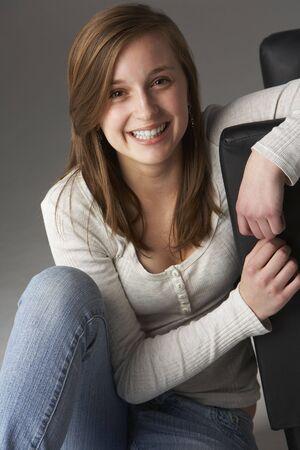 Teenage Girl Sitting In Studio photo