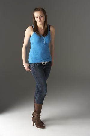 16 year old girls: Teenage Girl Standing In Studio Stock Photo