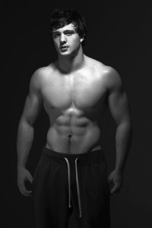 Studio Portrait Of Muscular Teenage Boy photo
