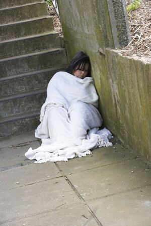 Homeless Girl Sleeping Rough photo