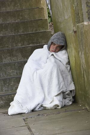 Homeless Boy Sleeping Rough Stock Photo - 5516930