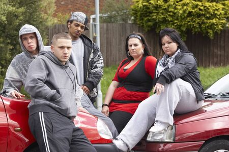 Gang Of Youths Sitting On Cars photo