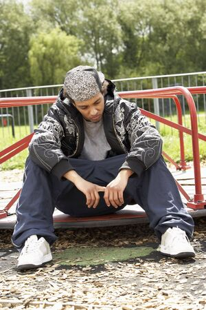 homeless man: Young Man Sitting In Playground