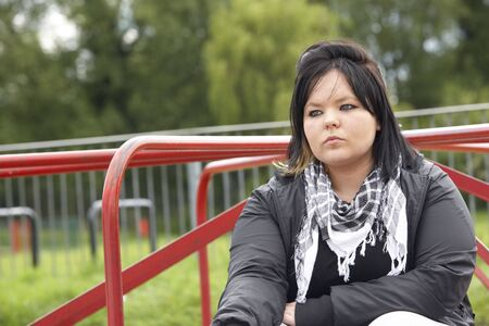 19 years old: Young Woman Sitting In Playground