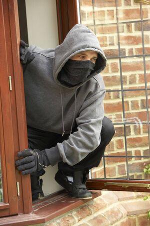 break in: Young Man Breaking Into House