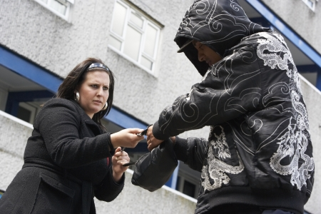 mugger: Man Mugging Woman In Street Stock Photo
