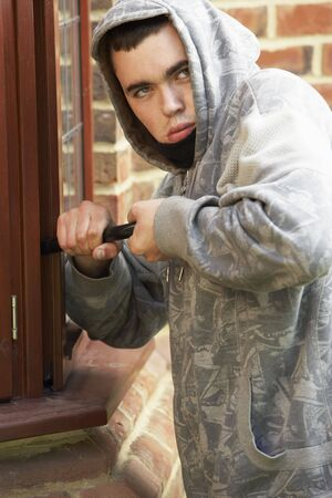 Young Man Breaking Into House photo