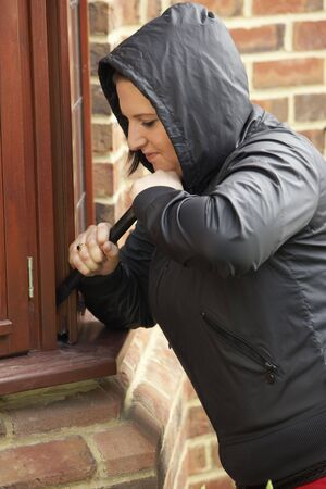 Young Woman Breaking Into House photo