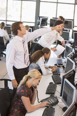 frantic: High Angle View Of Stock Traders At Work Stock Photo