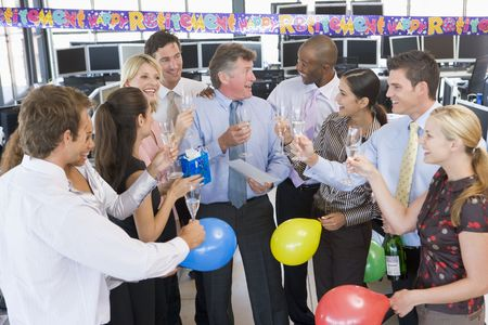 retiring: Stock Traders Celebrating In The Office Stock Photo