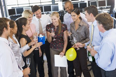 party room: Stock Traders Celebrating In The Office Stock Photo