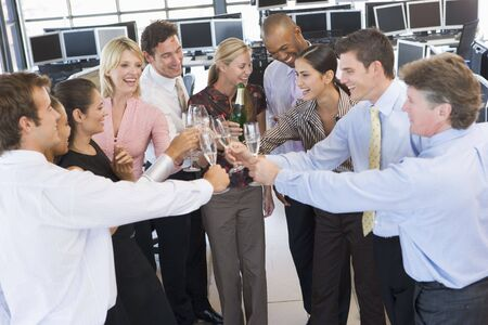stock traders: Stock Traders Celebrating In The Office Stock Photo