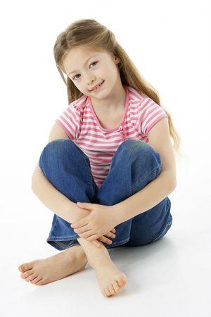 7 year old girl: Studio Portrait of Smiling Girl Stock Photo