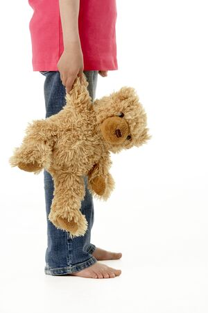 Studio Portrait of Girl Standing with Teddy Bear photo