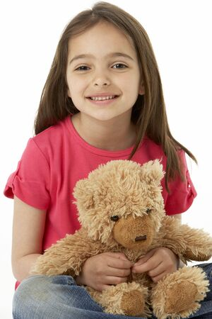 Studio Portrait Of Smiling Girl with Teddy Bear photo