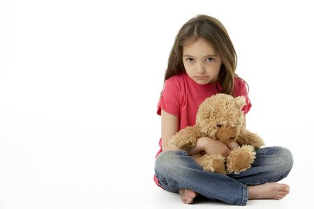 animal sad face: Studio Portrait Of Smiling Girl with Teddy Bear