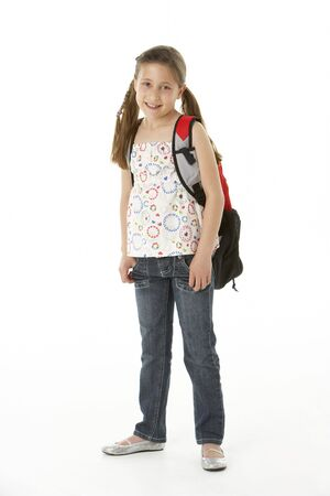 Studio Portrait of Girl Standing with backpack photo