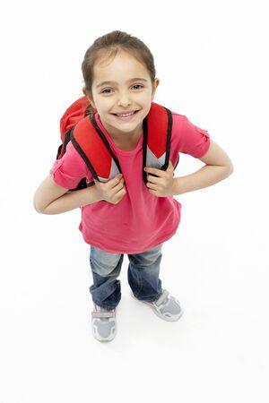 Studio Portrait of Smiling Girl Wearing School Bag Stock Photo - 5631173