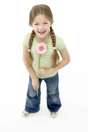 bunches: Studio Portrait of Smiling Girl Holding Flower