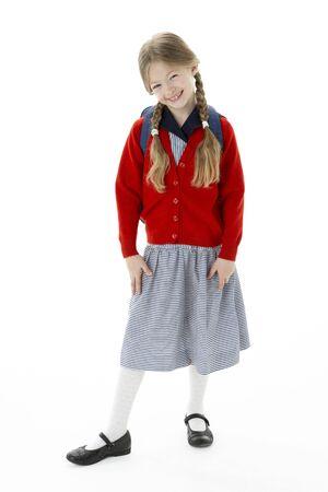 7 year old girl: Studio Portrait of Smiling Girl Wearing School Bag Stock Photo